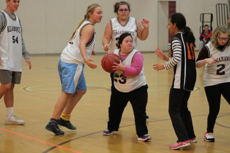 Unified Basketball shoots for smiles