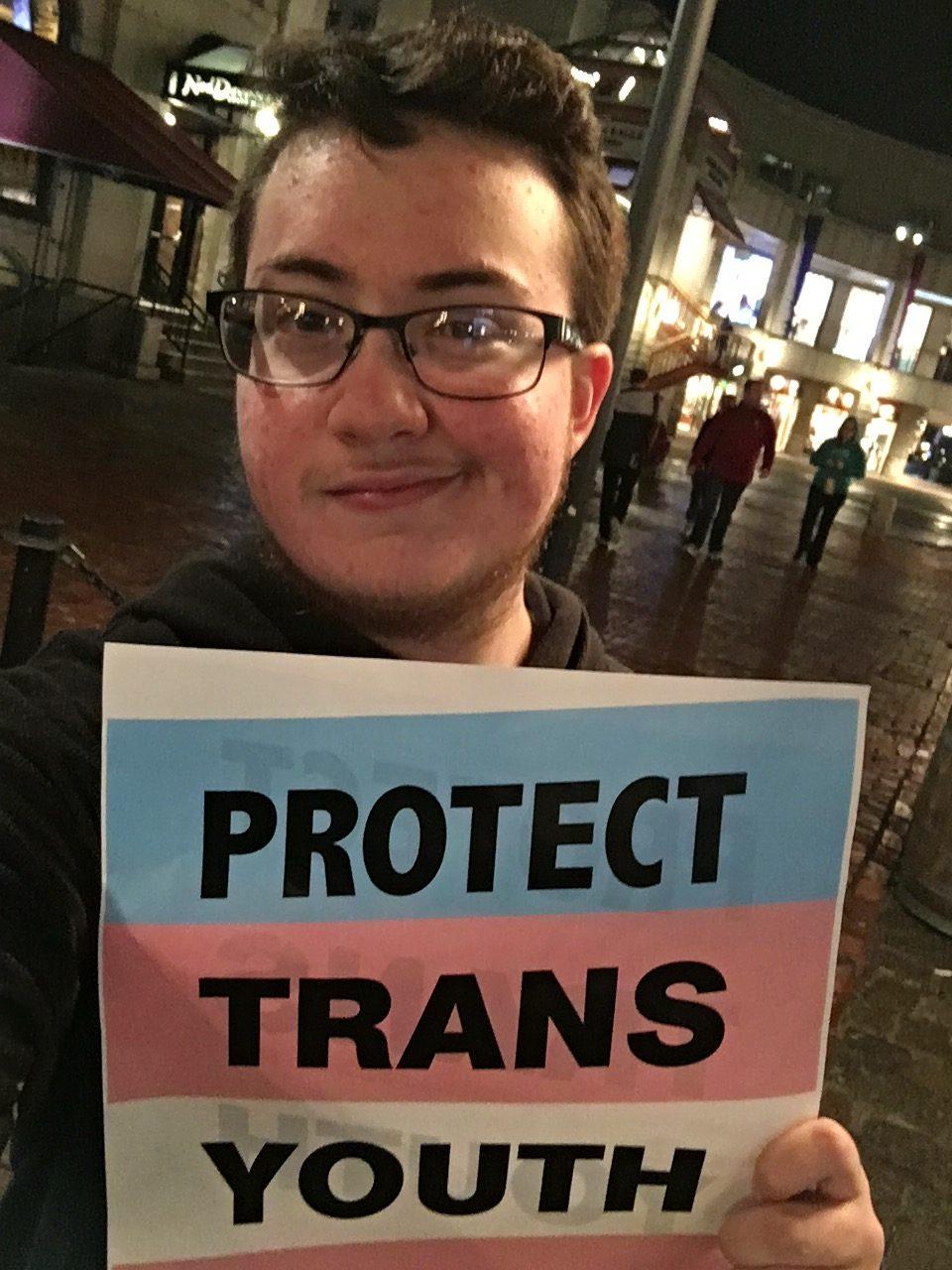 Sophomore Eli Cohen-Gordon attended a rally in Boston against President Trump's reversal of former President Obama's protections of transgender students.
