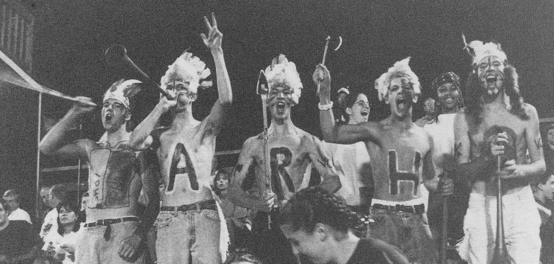 T-hawk fans in 1996 show school spirit with body paint and costumes.