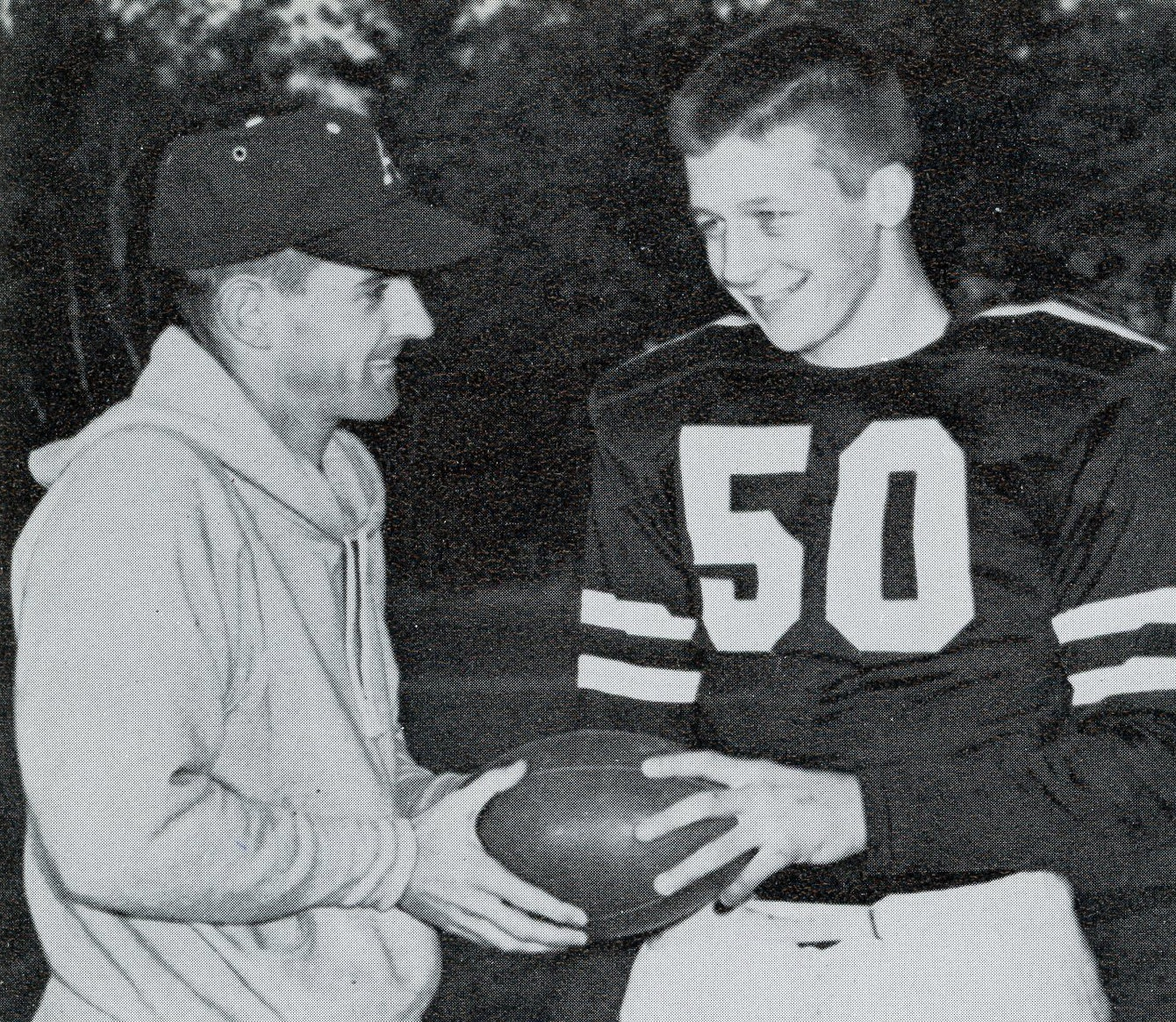 Dick Walsh at the first ARHS Thanksgiving Day football game with captain Paul Pisinski in 1959.