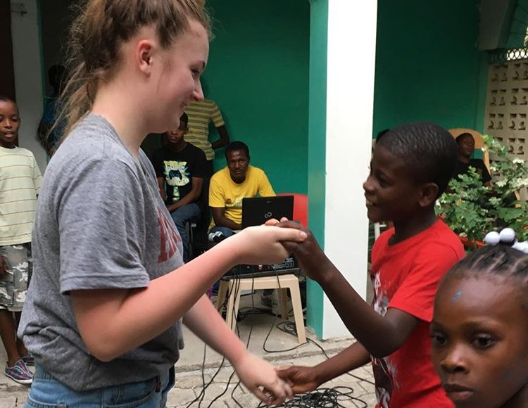 Sophomore+Lauren+Earley+%28left%29+traveled+to+Haiti+for+the+second+time+to+volunteer+at+an+orphanage.