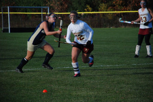 Molly Dore chases the free ball late in the game on Oct. 25 against Shrewsbury.