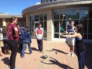Juggling club members, Garrett Maglio, senior, and Tal Usvyatsky, sophomore, show robotics team members, Sean O'Neil senior, and Jessie Sigler, senior, how it's done.
