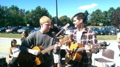 Senior, Nick DeFeudis and sophomore,  Nick Libby perform at the activity fair to encourage participation at Algonquin acoustics.