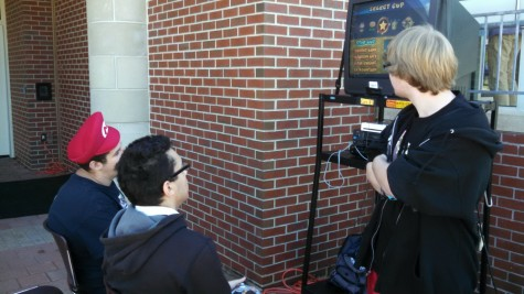 Junior Andrew Perry, president of the video game club, shows interested students what video game club is all about.