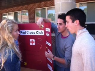 Senior Will Frank recruits senior Chrissy Foley to Red Cross Club.