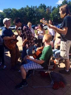 Algonquin Acoustics members, seniors Joe McCuine, Nick Defeudis, and Junior, Michael Dutko along with Sophomore, Nick Libby, Jam out together on a beautiful sunny day.