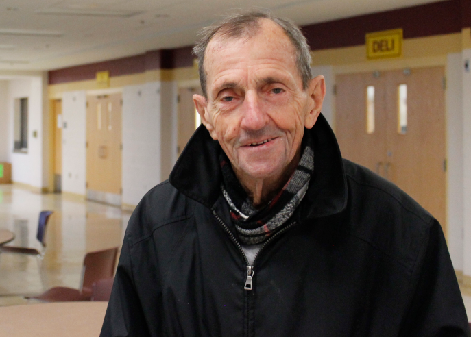 Mr.+Dick+Walsh%2C+who%27s+been+a+member+of+the+ARHS+community+for+more+than+60+years%2C+poses+for+a+picture+in+the+cafeteria+during+breakfast.