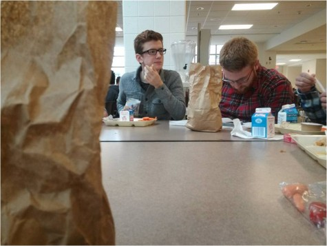 Seniors Max Slingluff and Henry Fournier enjoy some down time at lunch.