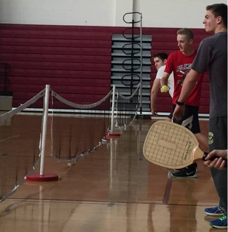 Seniors Andrew Travens, Connor Henderson and Ethan McRae engage in a pickleball tournament during gym class.