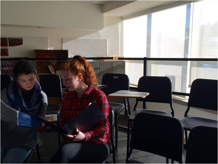 """Have we even learned this?"""" junior Selena Safiol said to junior Katherine Johnson as the two refreshed their memories on the music for chamber choir before class started on Tuesday, January 5."""