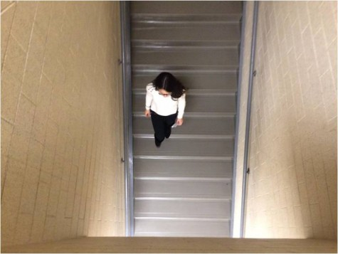 Freshman Larissa Andrade walks down the h300 staircase to class.