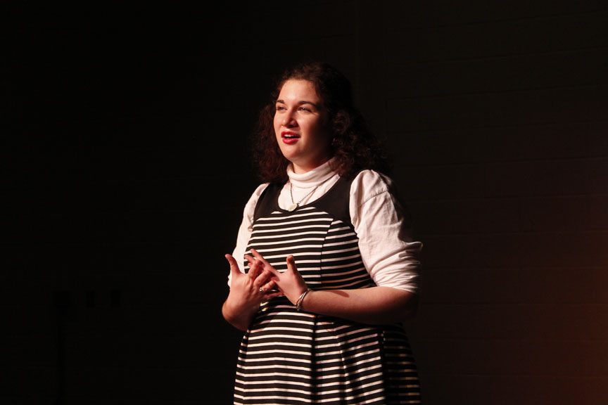 """Senior Hannah Moran recited  """"A Boat Beneath a Sunny Sky"""" by Lewis Carroll and """"Love Song"""" by Dorothy Parker on February 1 in the auditorium."""
