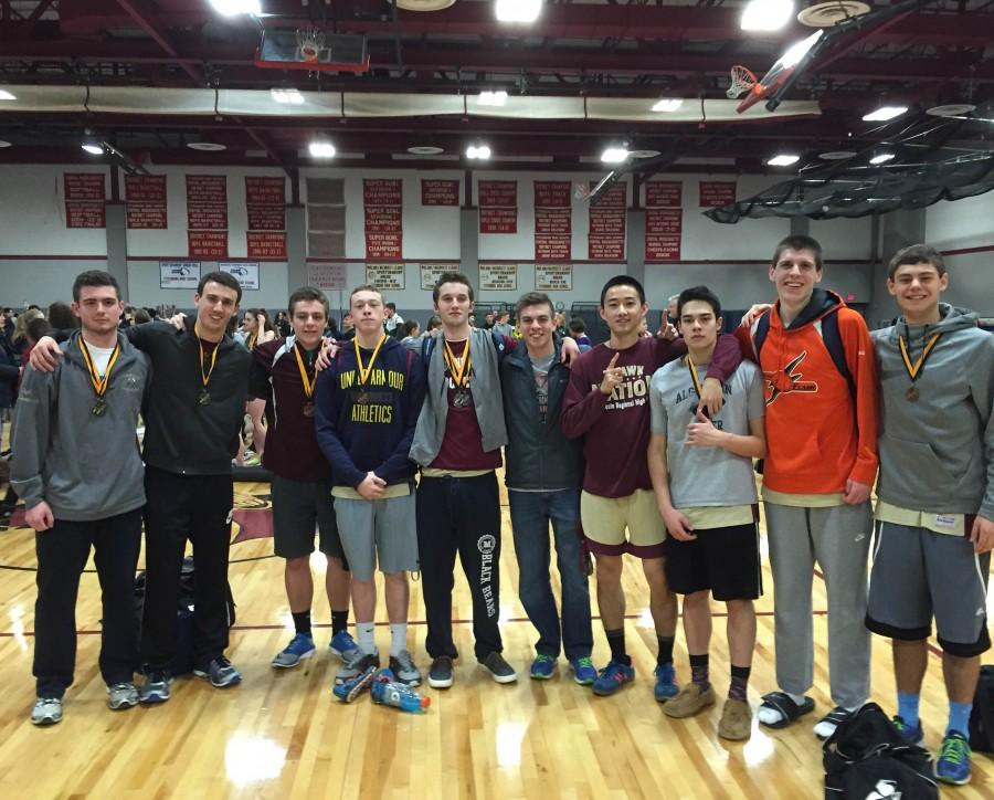 After+winning+the+boys%27+indoor+track+Midland-Wachusett+A+league+title%2C+seniors+pose+with+their+medals+on+Saturday+January+30+at+Fitchburg+High+School.