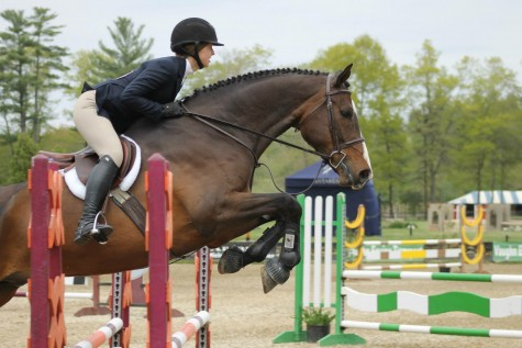 Krinsky sails over a three-foot oxer in an over fences class.