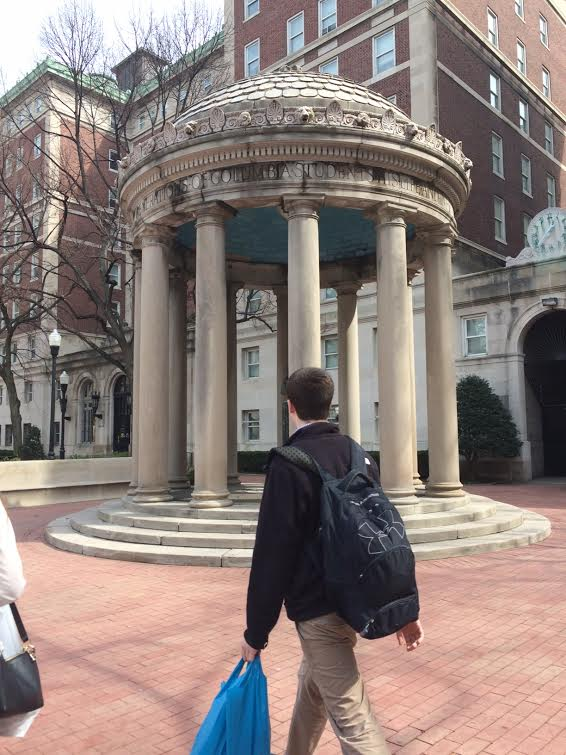Riley Garand admiring the classic architecture of the Colombia campus.