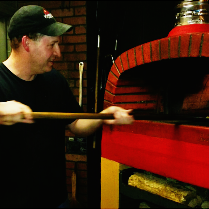 Kindles Pizzeria shows the wood-fired Italian oven where all the magic happens.