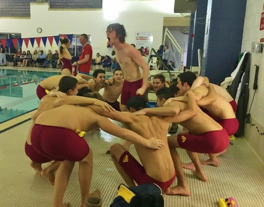 Following tradition, senior Peter Bryne leads members of the boys' swim team in a pre-meet cheer against Westborough.