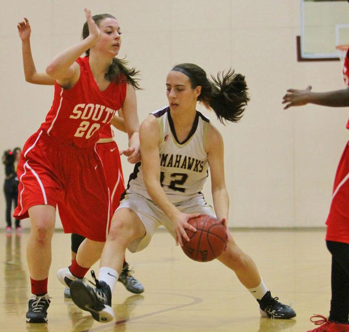 Senior captain Caroline Leonard drives to the hoop against Worcester South on March 1.