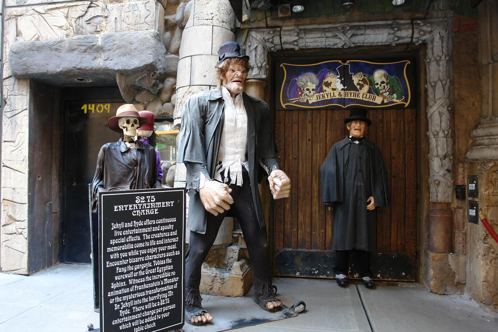 Mysterious figures await hungry travelers outside of The World Famous Dr. Jekyll and Mr. Hyde Club restaurant in New York City.