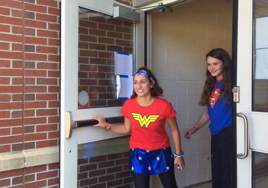 Freshmen Anna Lidsky and Jordan Manousos rush out of the exterior girls locker room doors in order to beat the alarm which sounds after 30 seconds.