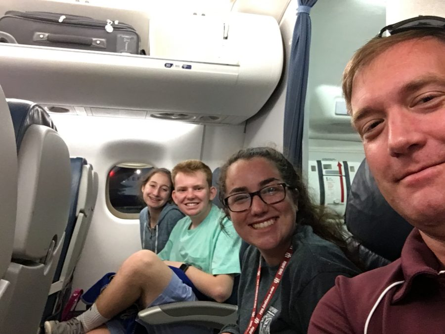 Advisor Kevin Hausmann takes a selfie with club leaders Kate Crimmings, Ryan Strobel, and Isabella Masciarelli on their way to the Leadership Conference.