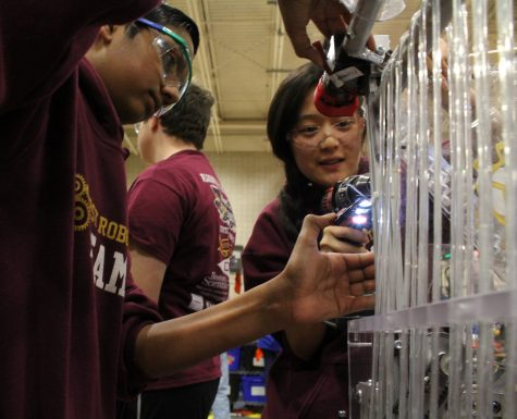 Robotics teammates build each other up