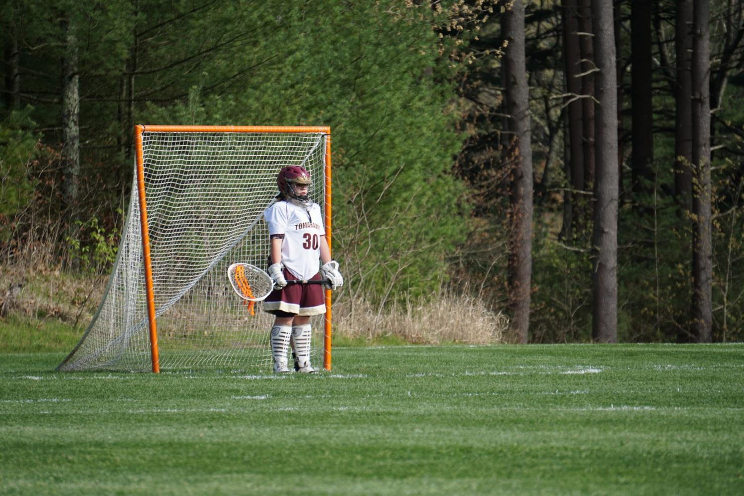 Sophomore+goalie+Erin+Blake+stands+reading+the+field%2C+waiting+to+block+the+next+ball.
