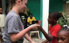 Earley travels to Haiti, helps children in orphanage