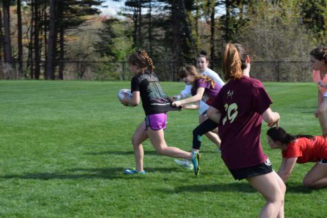 Girls' rugby remains undefeated through practice, hard work