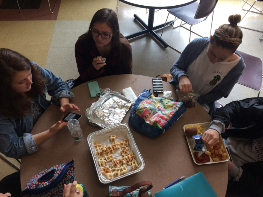 Juniors Katie Zieminski, Maggie Shoemaker, and Isabella Masciarelli chat about the Global Awareness projects that the AP students have been advertising during lunch.