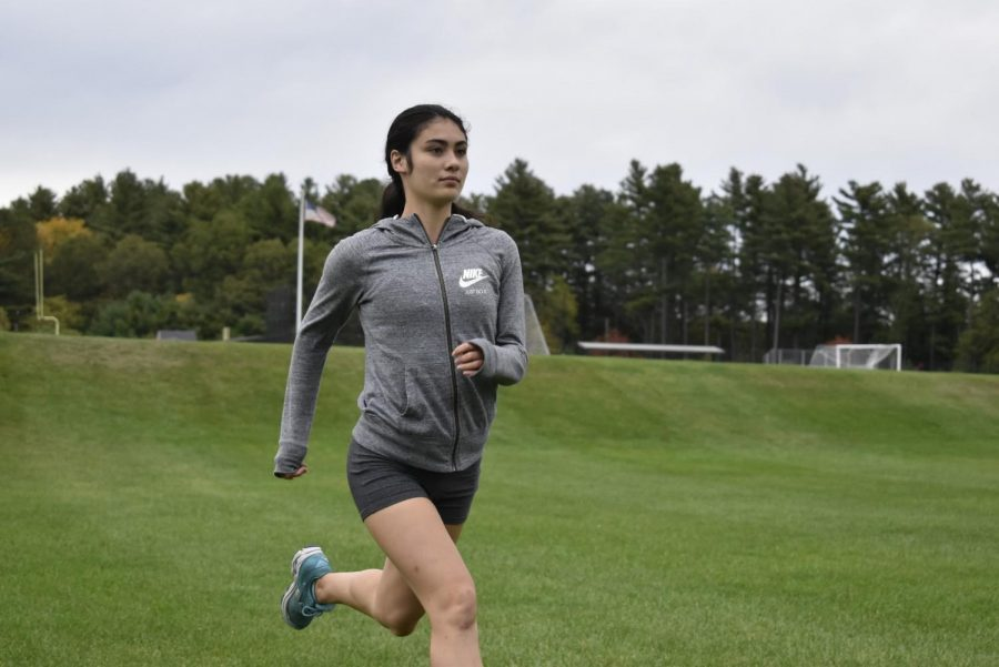 Junior Tess Reyes trained hard in order to break Algonquin's home course cross country record.