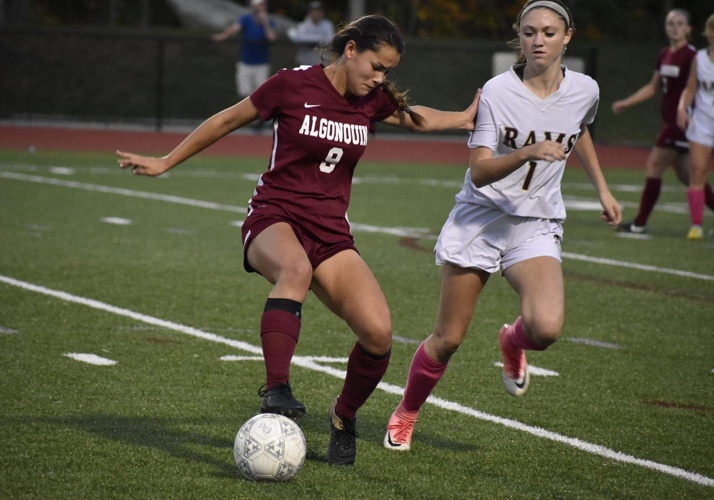 Junior Jacqui Moy controls the ball at Shepherd Hill on  October 10.