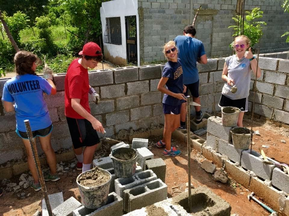Sophomore Abby Barnes (right) traveled to the Dominican Republic, rebuilding a house and teaching children in impoverished areas.