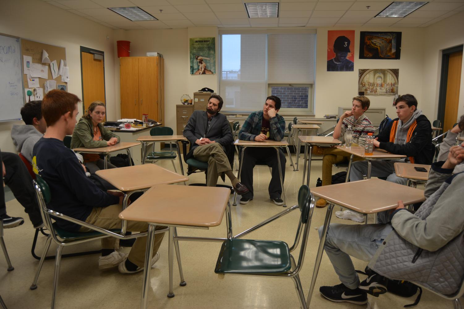World language teacher and Philosophy Club advisor Phil Levine ponders topics discussed at a club meeting.