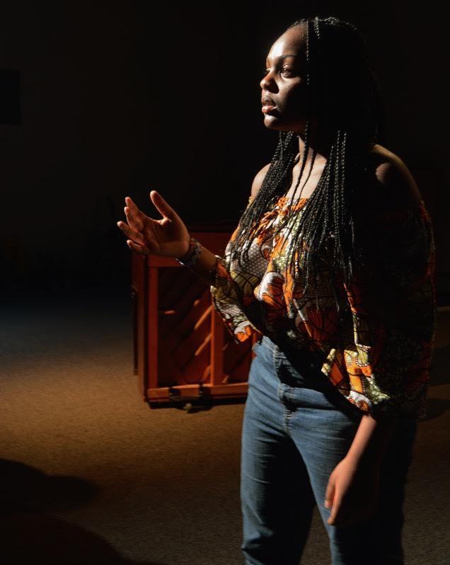 Freshman Edna Kinyanjui recites her poem at the semi-finals in the black box  on January 17.