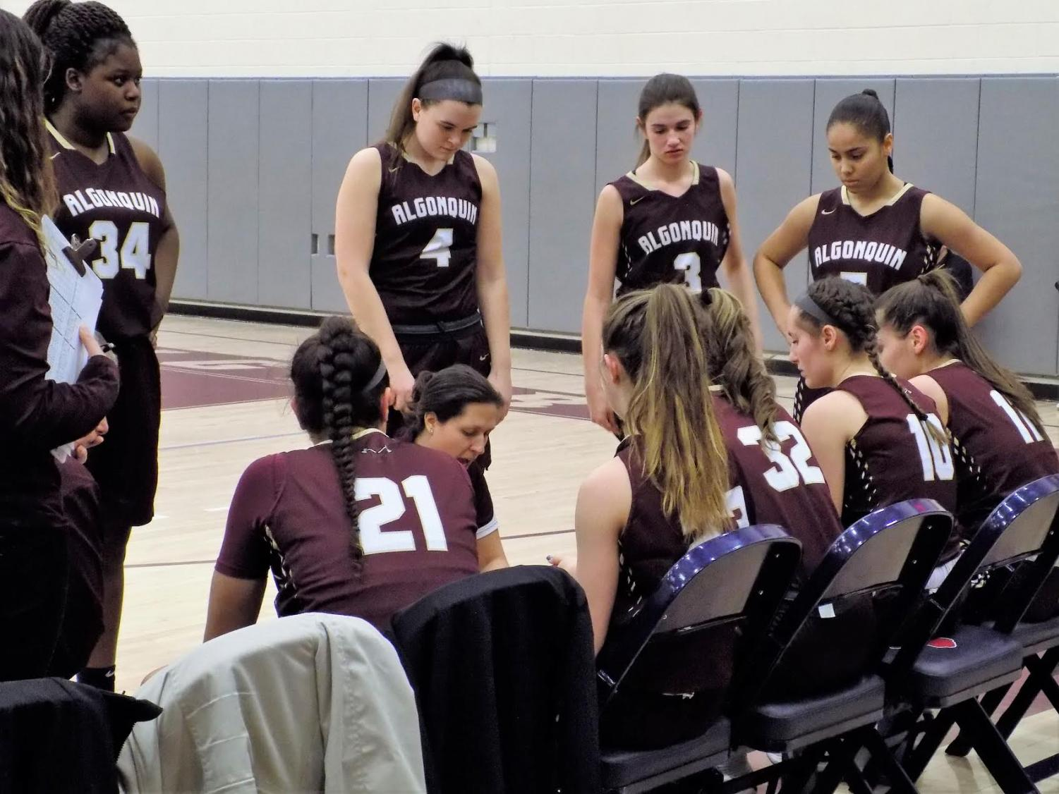 Coach Mel Fustino gives a pep talk as the team gets ready to get back into the game against Westborough on February 19. The team played hard for the win, with the final score being 63-51.