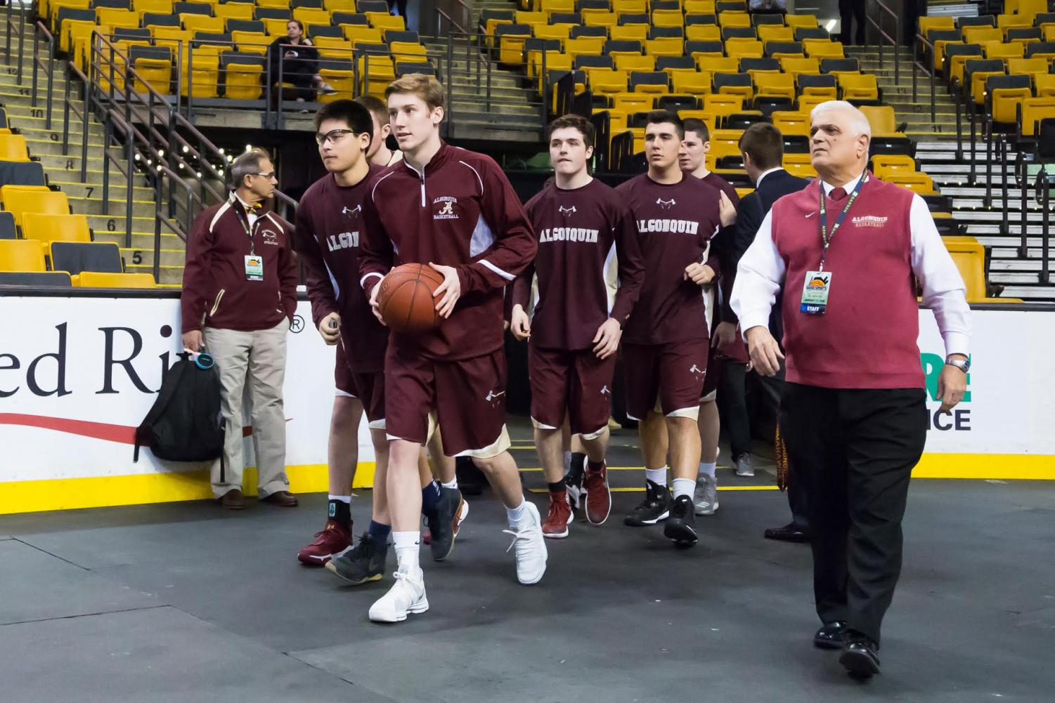 Boys' basketball walks onto the court at TD Garden to play against Westford Academy.