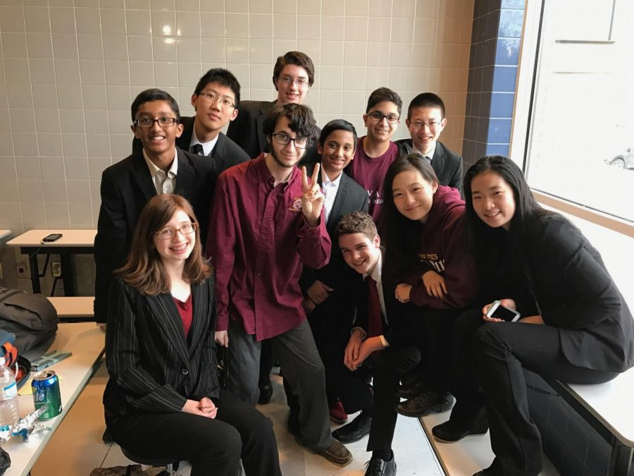 The+Speech+and+Debate+Club%27s+junior+vice+president+Nellie+Zhang+%5Bfar+right%5D+shares+what+goes+on+in+club+meetings.+
