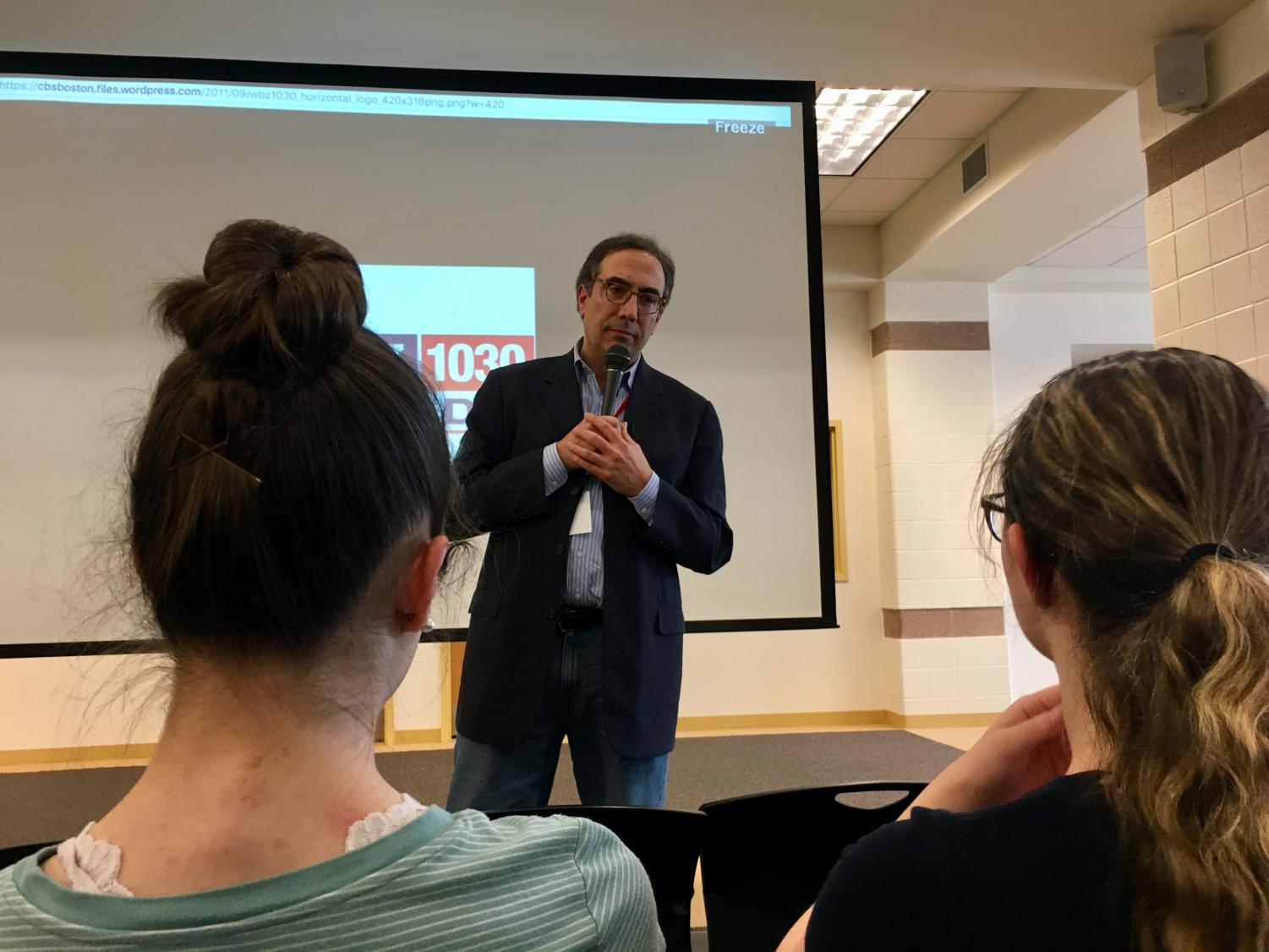 WBZ morning radio anchor Josh Binswanger engages with the audience during a Q&A session following his broacast career presentation with co-worker Matt Ledin.