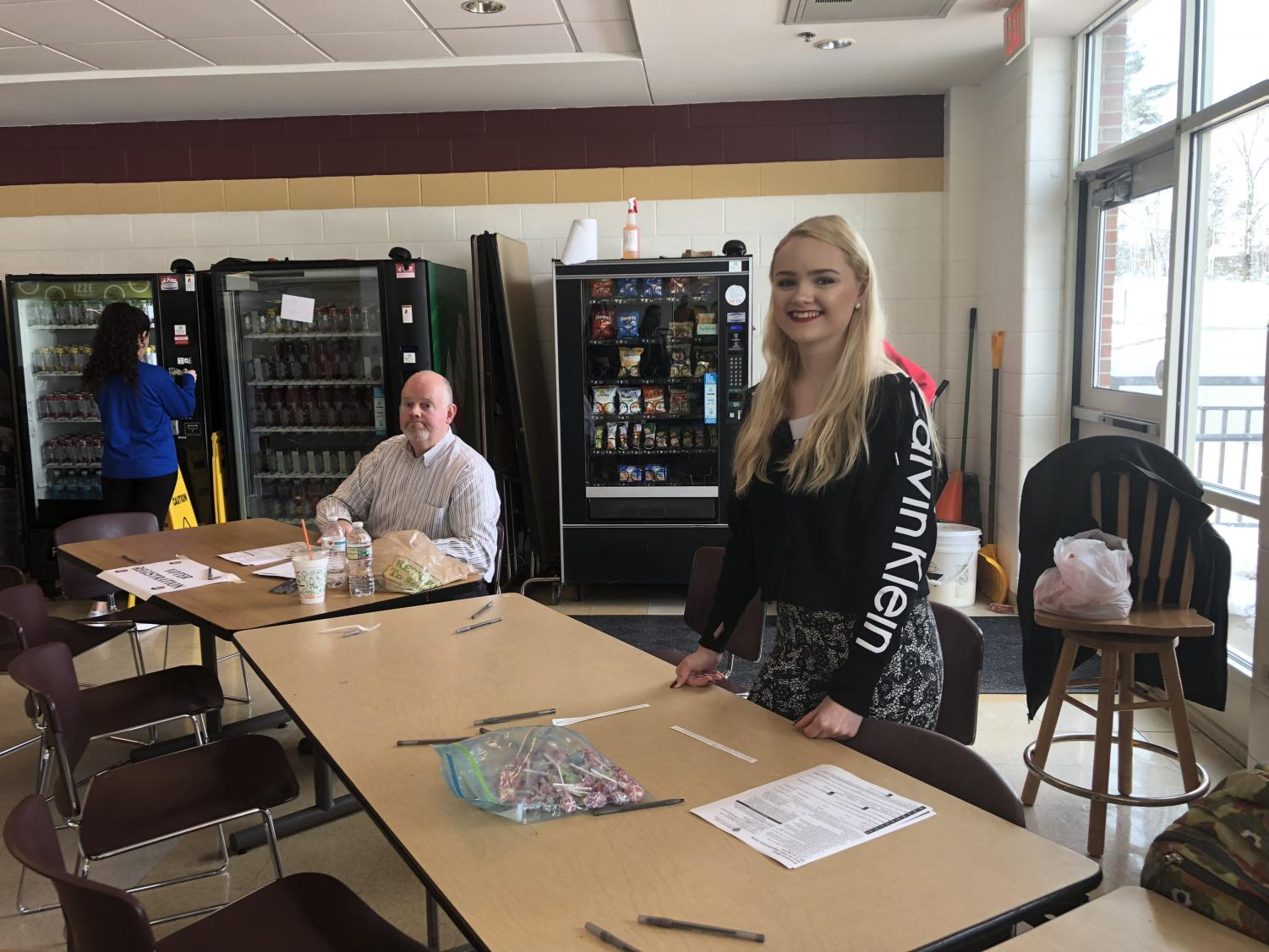 Junior Rebecca Snow helped students in registering to vote during lunch on March 14.