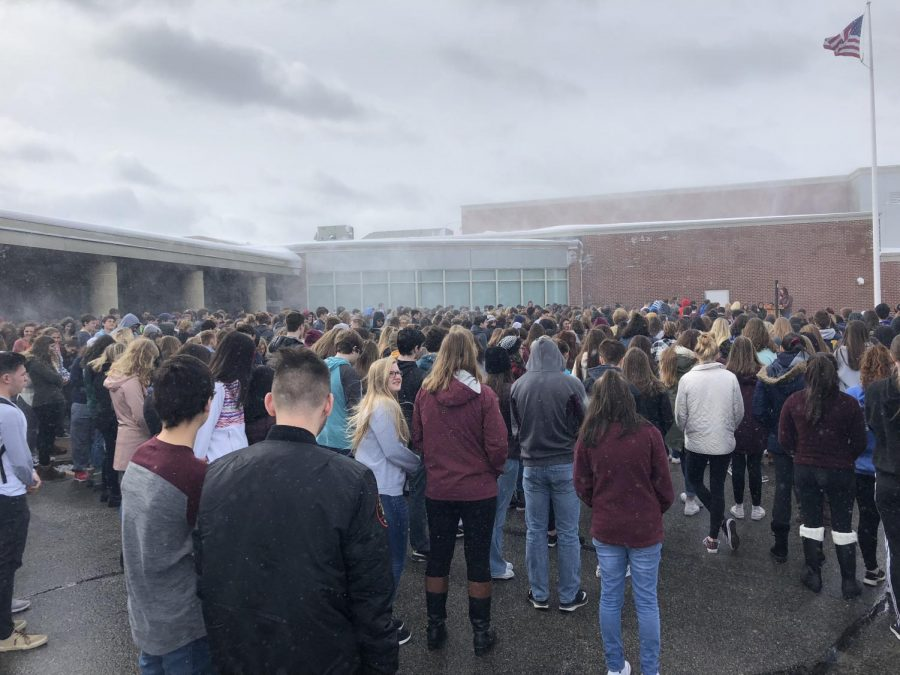Students stand in solidarity amid the flurry of snow.