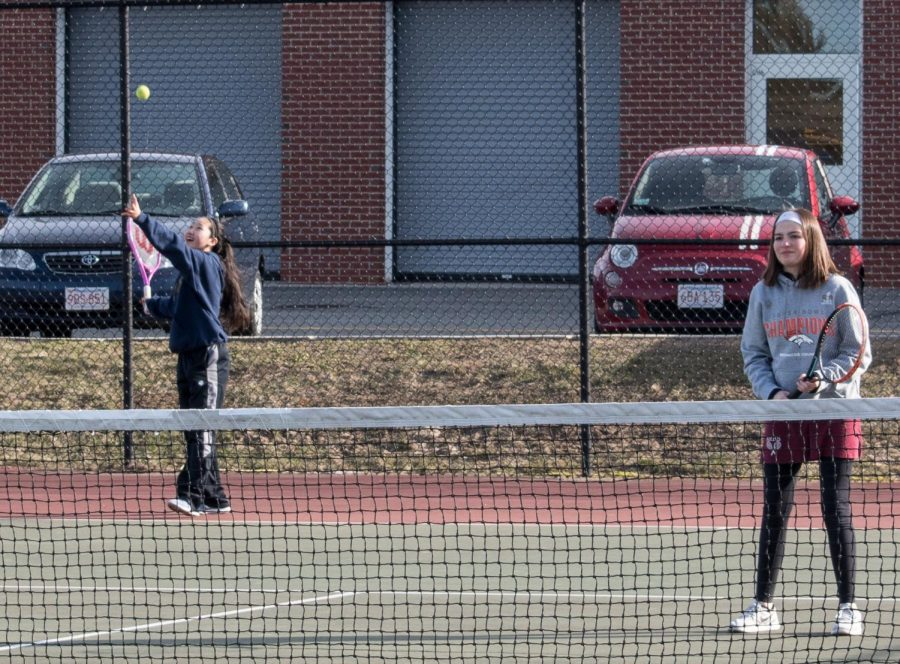 Freshman+Emily+Wu+serves+the+ball+in+a+match+against+Hopedale.