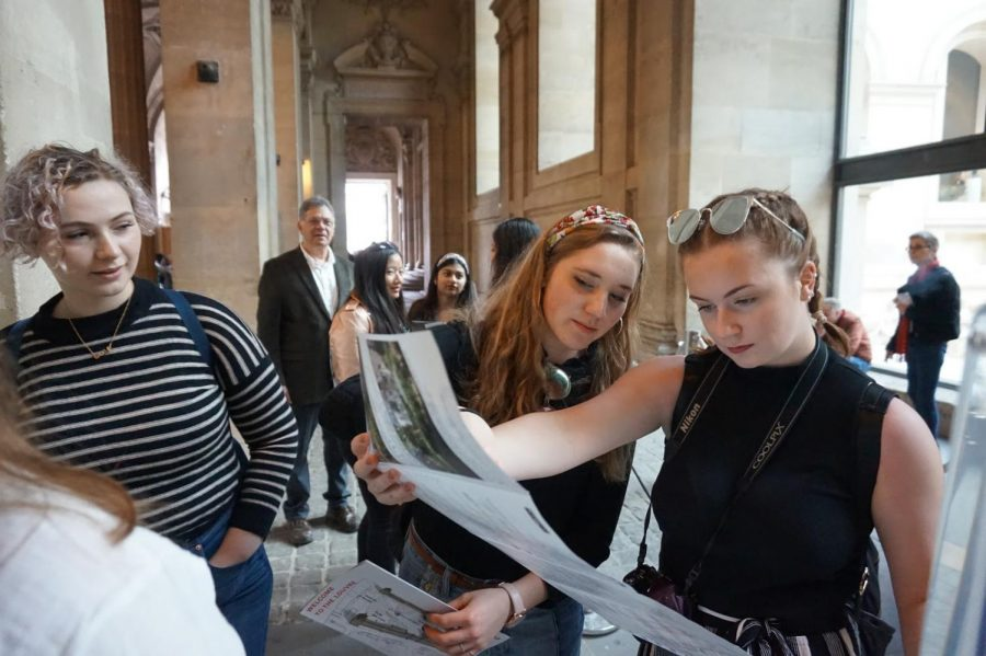 Juniors Lauren Earley and Annalise Loizeaux gaze at the map of the Louvre, one of the largest museums in the world, which is home to Leonardo da Vinci's Mona Lisa.