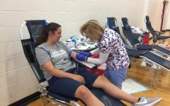 Student volunteers donate at annual blood drive