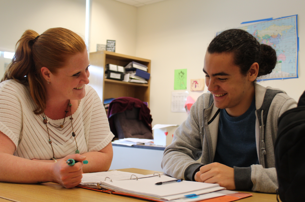Alissa Luippold happily works with sophomore Michael McWilliams.