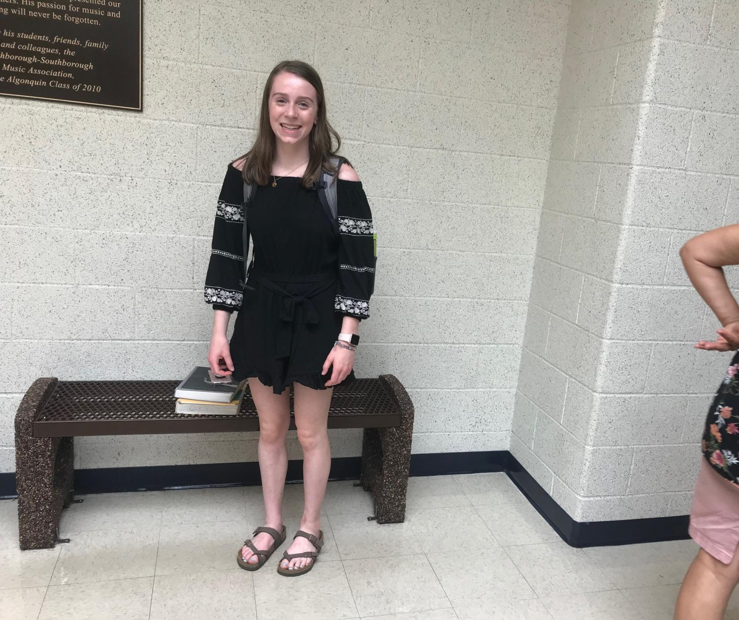 Having+gotten+through+the+first+day+of+school%2C+Junior+Elizabeth+Shaw+smiles+while+showing+off+her+trendy+black+romper+and+Birkenstock+sandals.