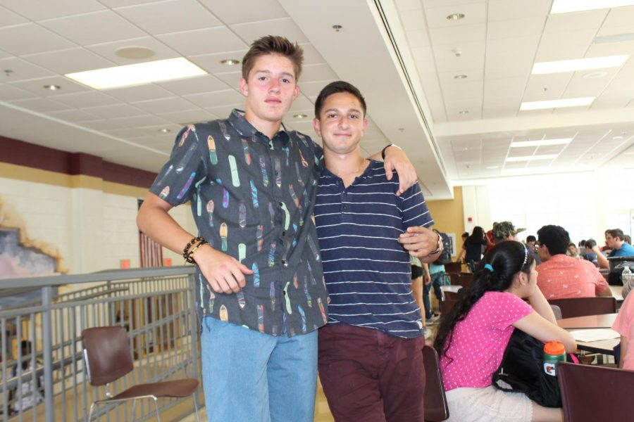Seniors Alex Lemieux and Matt White go for a causal   look with button down shirts and colored shorts.