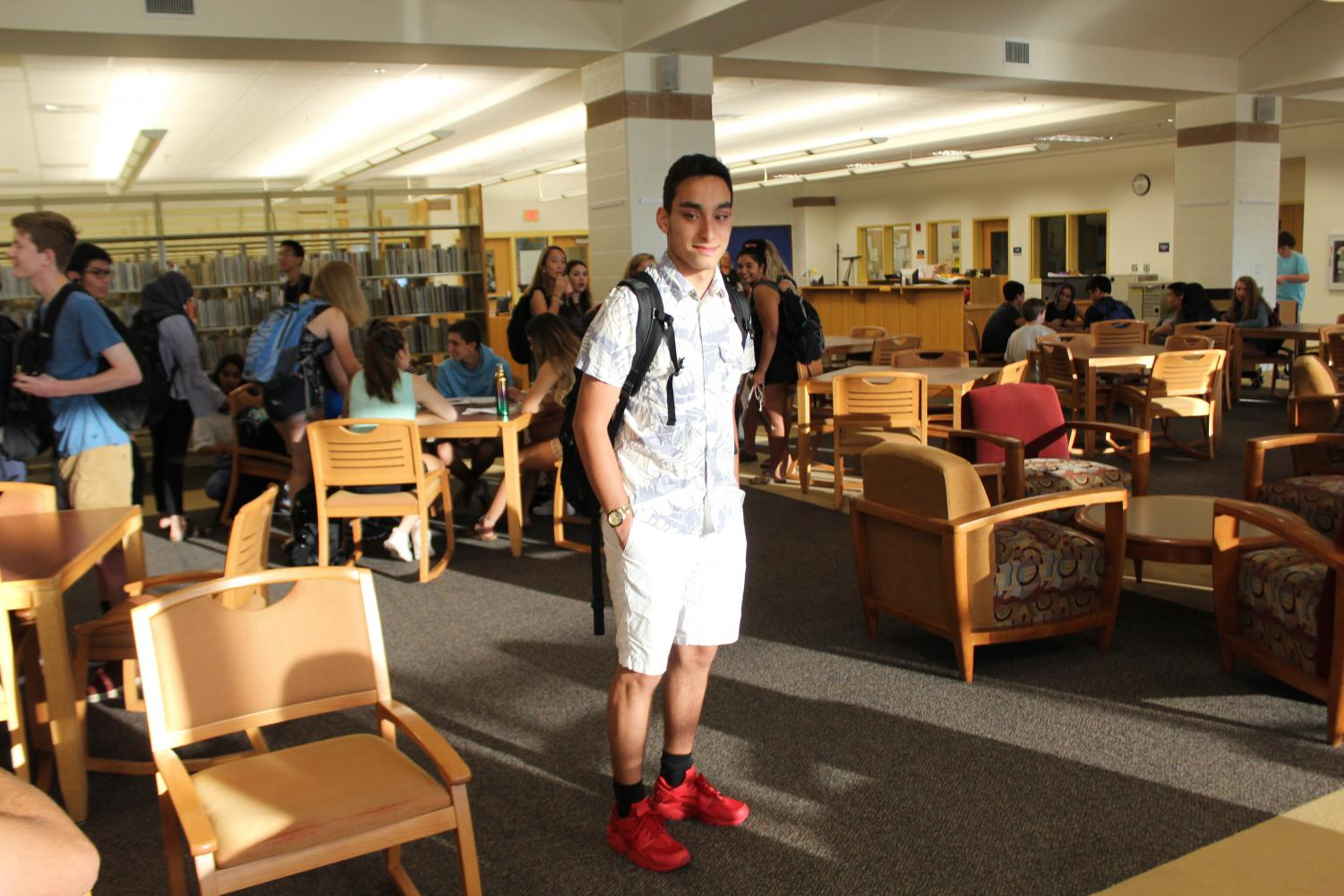 Senior+Aaron+Nodoushani+picks+a+tropical+look+for+the+first+day%2C+sporting+a+floral+button+down+and+white+shorts.