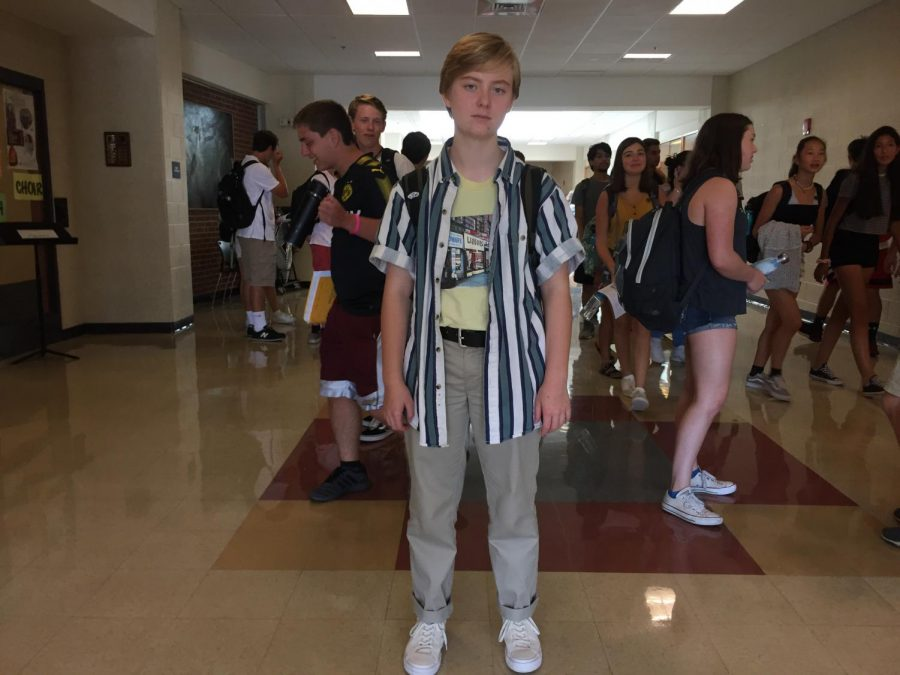 """Junior Ella Sandford sports a thrifted button up over a supreme shirt coupled with a thrifted belt and white converse one stars. """"I wanted to wear something that wasn't super boring on the first day, but I didn't want to be crazy extra,"""" Sandford said."""